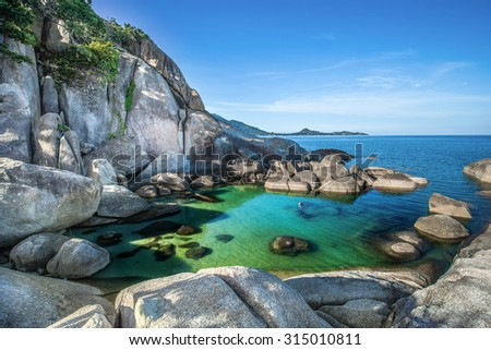 Beautiful rock and sea with blue sky at Hin Ta and Hin Yai Rocks ( grandmother and grandfather) in Koh Samui, Thailand - stock photo