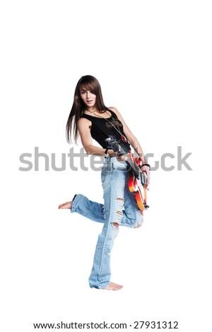 Beautiful rock-n-roll girl playing a guitar - stock photo