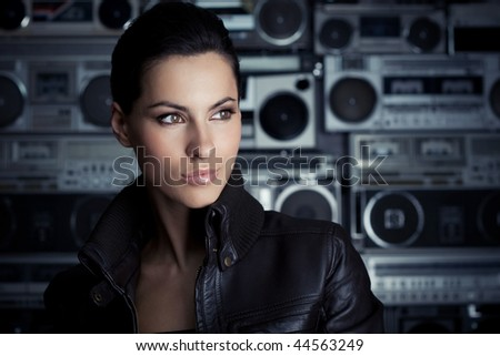 Beautiful rock woman with Boom Box background - stock photo