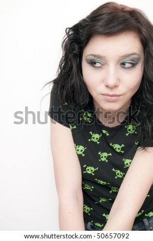 Beautiful Rocker Girl looking aside - stock photo