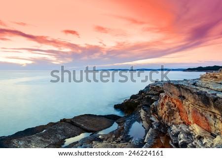 Beautiful rocks and sea. Sunrise over the sea near Rt Kamenjak, Croatia - stock photo