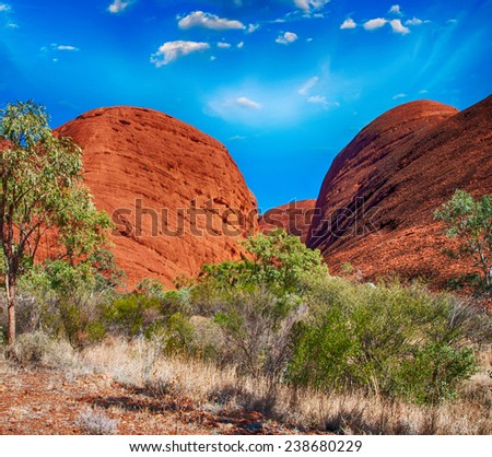 Beautiful rocks of Australian Outback against colourful sky. - stock photo
