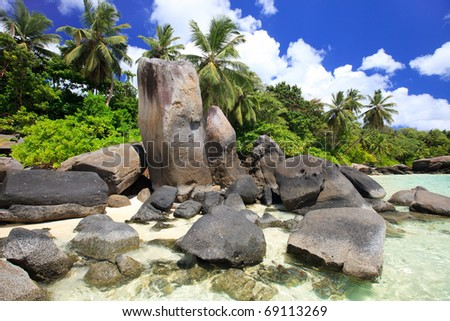 Beautiful rocky coast and turquoise ocean waters in Seychelles - stock photo