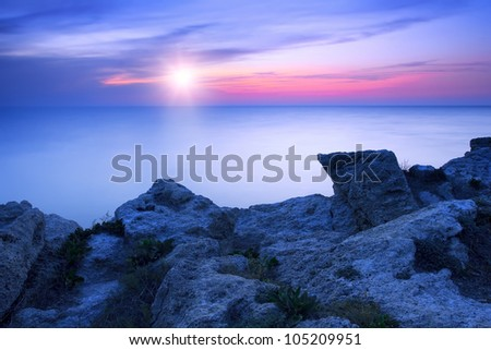 Beautiful rocky sea coast at the sunset