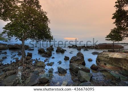 Beautiful rocky sea shore at sunrise or sunset on Island Phu Quoc. VietNam - stock photo