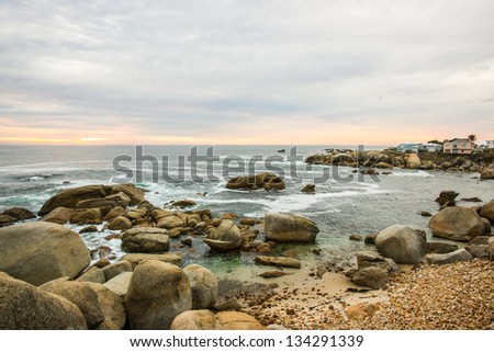 Beautiful rocky seascape in Cape town city shot during sundown - stock photo