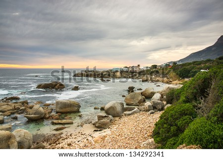 Beautiful rocky seascape in Cape town city shot during sundown - stock photo