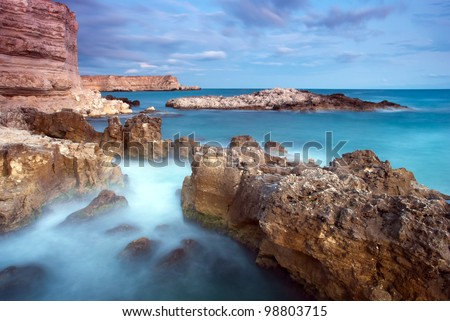 Beautiful rocky seaside at the sunset - stock photo
