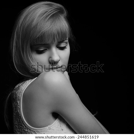 Beautiful romantic blond woman looking down. Black and white portrait. Closeup - stock photo