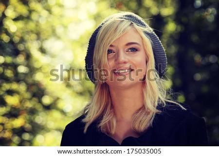 Beautiful romantic blonde with autumn background close-up portrait - stock photo