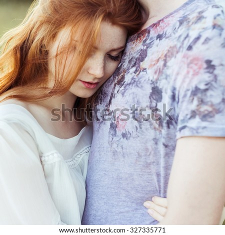 beautiful romantic couple in love hugging in the warm sunny day - stock photo