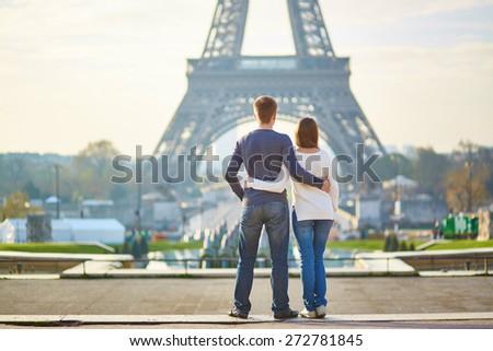 Beautiful romantic couple in Paris near the Eiffel tower - stock photo
