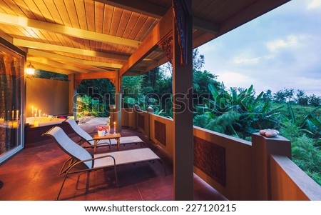 Beautiful Romantic Deck on Tropical Home at Sunset with Candles - stock photo