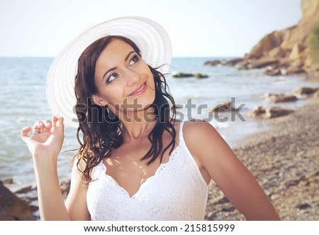 Beautiful romantic girl on the beach. Summertime - stock photo