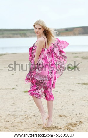 Beautiful romantic girl on the yellow sand - stock photo