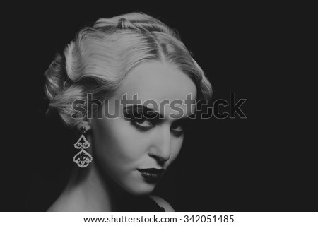 Beautiful romantic image of a girl in 20s style. Beautiful blonde in a stylish dress on a dark background. Professional makeup and jewelry design. Photo for fashion magazines, posters and websites.