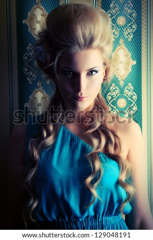 Beautiful romantic lady posing in the  vintage interior. - stock photo