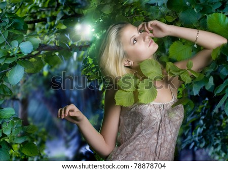 Beautiful romantic woman at misty forest - stock photo