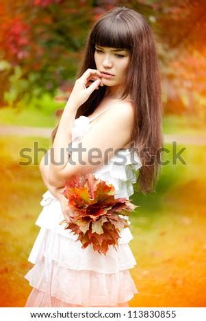 Beautiful romantic woman in autumn. - stock photo
