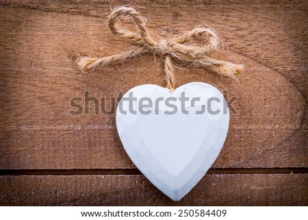 beautiful romantic wooden vintage hearts on a wooden background - pictures concept theme Love and St. Valentine's Day - stock photo
