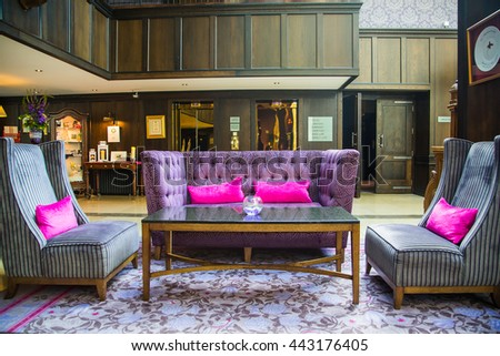 Beautiful room interior design in the Castle hotel in Dublin with purple sofas in the middle. - stock photo