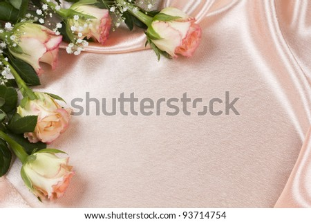 Beautiful rose on a background pink silk - stock photo
