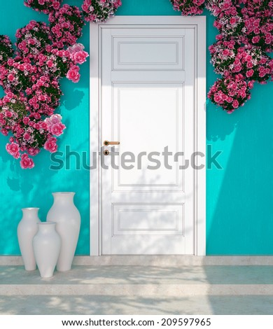 Beautiful roses and door in front of blue wall. Entrance of a house. - stock photo