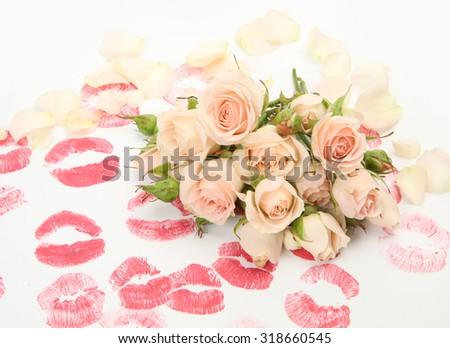 beautiful roses and lipstick prints - stock photo
