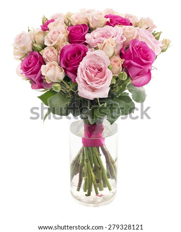 Beautiful roses bouquet in a glass vase isolated on white background - stock photo