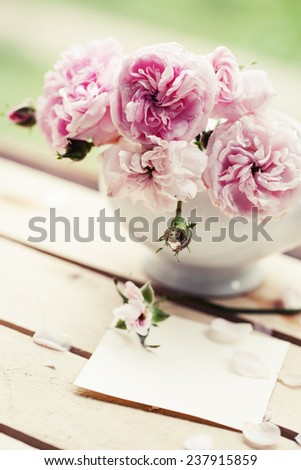 Beautiful roses in a vase in vintage style/ Gentle flower background