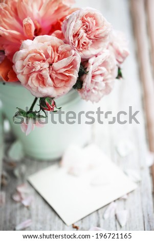 Beautiful Roses in a vase with card   - stock photo