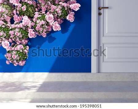 Beautiful roses in front of blue wall. Entrance of a house. - stock photo