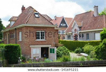 beautiful rural, brick house in the Dutch style - stock photo