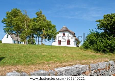 beautiful rural irish cottage to rent  - stock photo