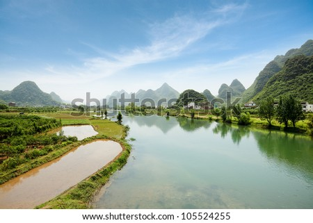 beautiful rural scenery of yangshuo, the yulong river with karst landform. - stock photo