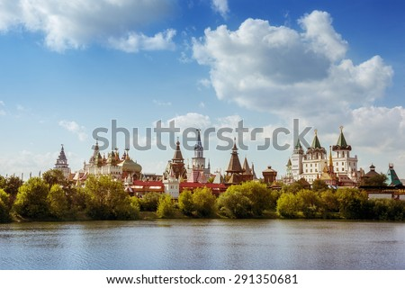 Beautiful russian landscape of Izmailovsky kremlin with pond against cloudy sky backdrop. Moscow city, Russia. Summer photo - stock photo
