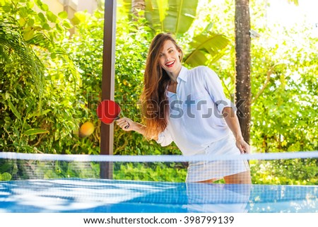 beautiful russian woman playing table tennis - stock photo