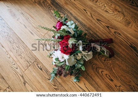 beautiful rustic wedding bouquet on wood background