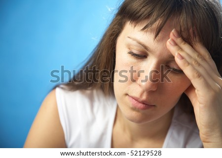 beautiful sad woman holding her head feeling stress or pain