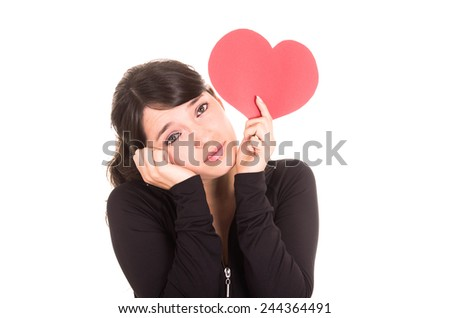 beautiful sad young girl holding a red heart concept of heartbreak isolated on white - stock photo