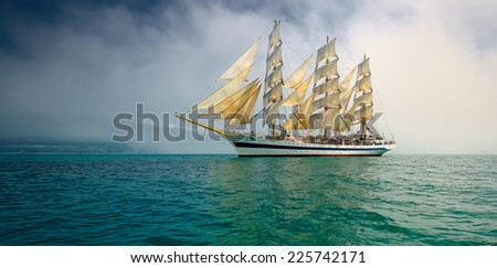 Beautiful sailboat in the fog - stock photo