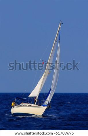beautiful sailboat sailing sail blue Mediterranean sea ocean horizon - stock photo