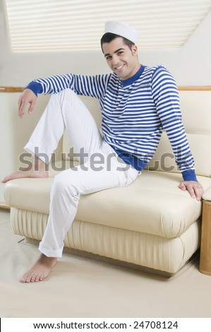beautiful sailorman wearing sailor clothes into a yatch - stock photo