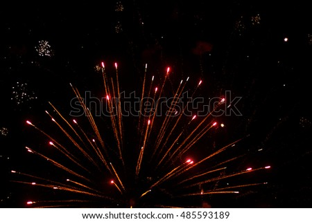 Beautiful salute and fireworks with the black sky background. Abstract holiday background with various colors fireworks light up the night sky