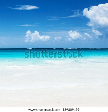 Beautiful sandy beach, ocean landscape, luxury spa resort, seascape, blue sky, summer romantic traveling concept - stock photo