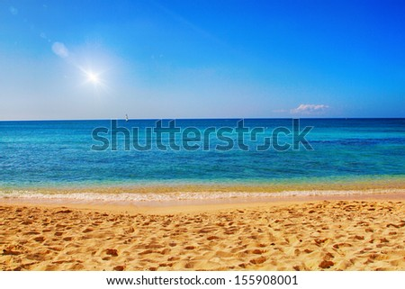 Beautiful sandy beach with bright colors and lens flare effect - stock photo