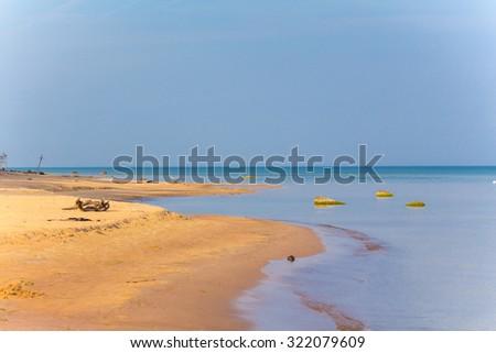Beautiful sandy shoreline landscape sea beach sky - stock photo