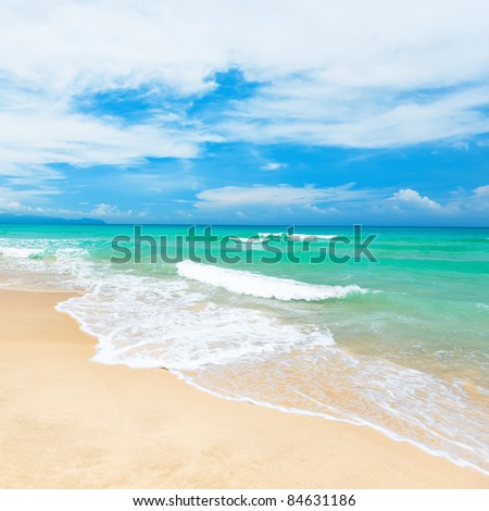 Beautiful sandy tropical beach at sunny day - stock photo