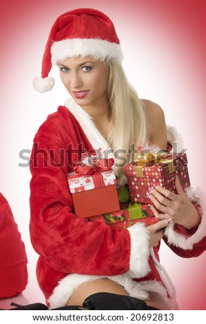beautiful santa claus holding some present boxes between arms - stock photo