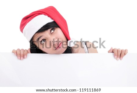 Beautiful santa girl thinking and holding a blank board isolated on white background